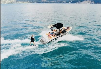Charter Motorboat Correct Craft Super Air Nautique 210 Annecy